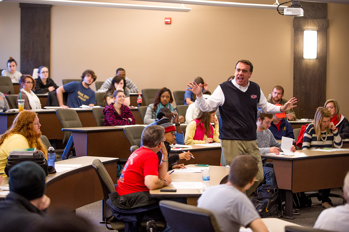 Arkansas State University Professor teaching a lesson in the College of Business.