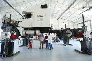 Arkansas State University - Newport Students listening to their instructor in the Diesel Program.